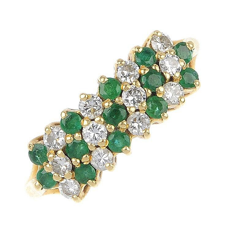 an 18ct gold and emerald dress ring