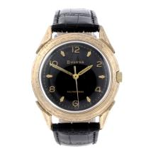 BULOVA - a gentleman's wrist watch. Gold plated case with stainless steel c