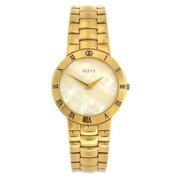 7f6267468 A gold plated quartz gentleman s Gucci 3300.2.M bracelet watch.