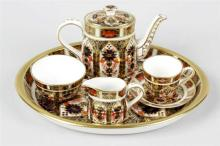 A boxed Royal Crown Derby Imari pattern miniature coffee service