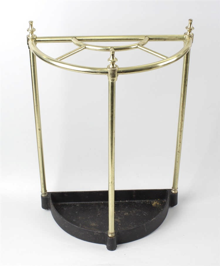 A brass and iron demilune stick stand The semicircular tub