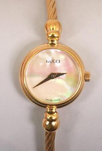 739f51bb3a9 GUCCI - a ladies gold plated watch