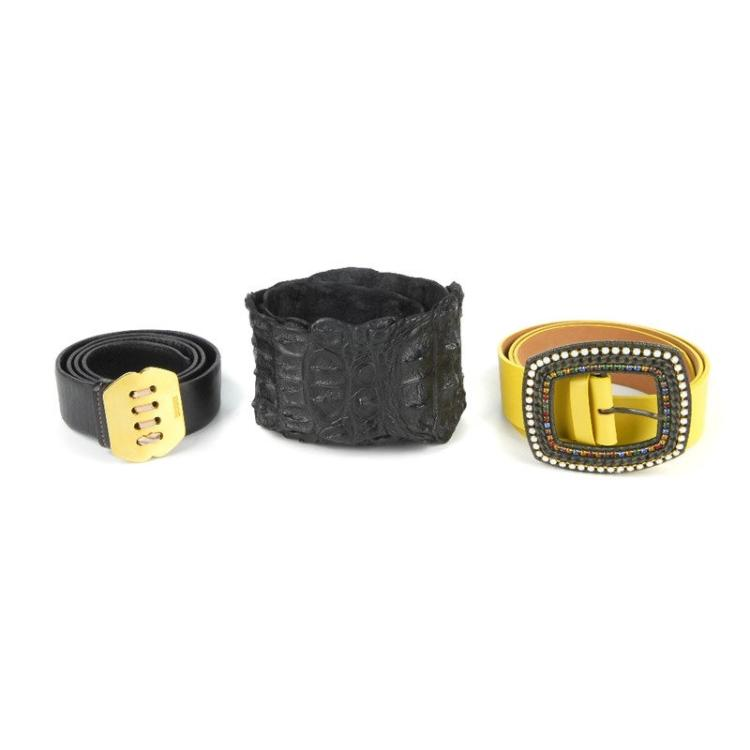 three designer belts to include a yellow leather belt by et