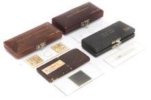 Four Cased Microscope Slides,