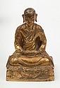 A gilt bronze figure of the arhat Ajita