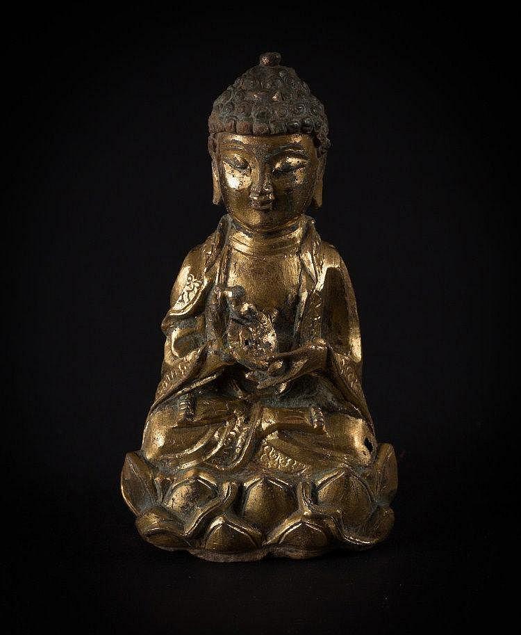 A bronze figure of Buddha China, Ming Dynasty, 17th Century