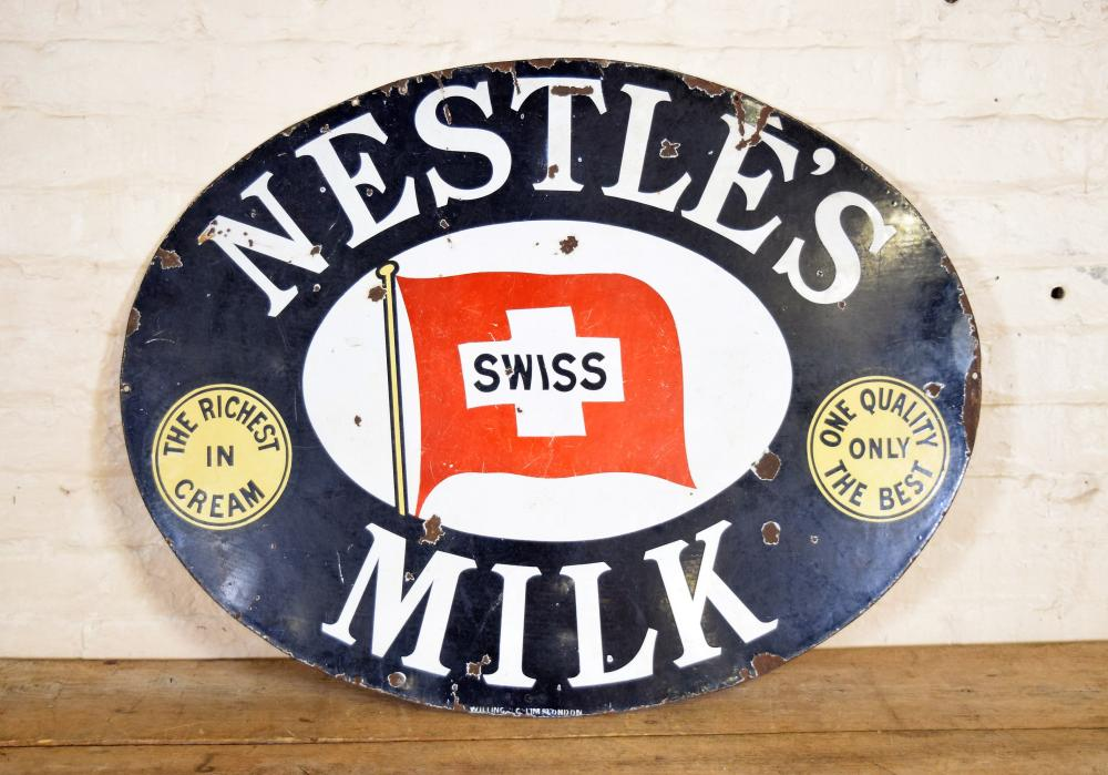 Vintage English Nestle's Swiss Milk Metal Sign