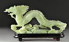 A Large Chinese Serpentine Sculpture of a Dragon