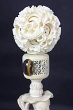 Chinese Carved Ivory Boy w/ Puzzle Ball