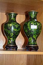 Pair of oriental cloisonne vases, each on wooden stand