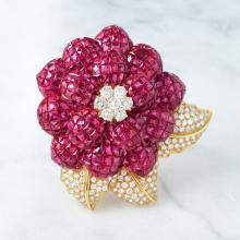 A Diamond and Ruby Invisibly-Set Brooch