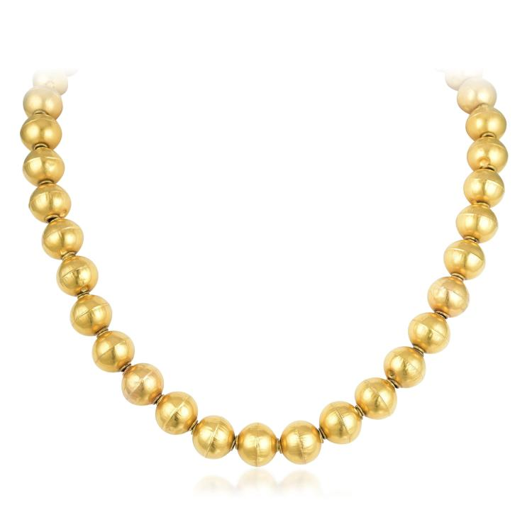 a gold bead necklace