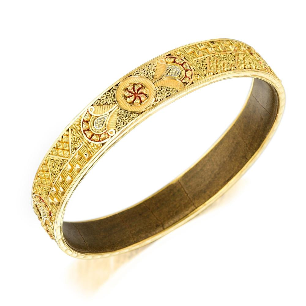 An Intricate Design Gold Bangle