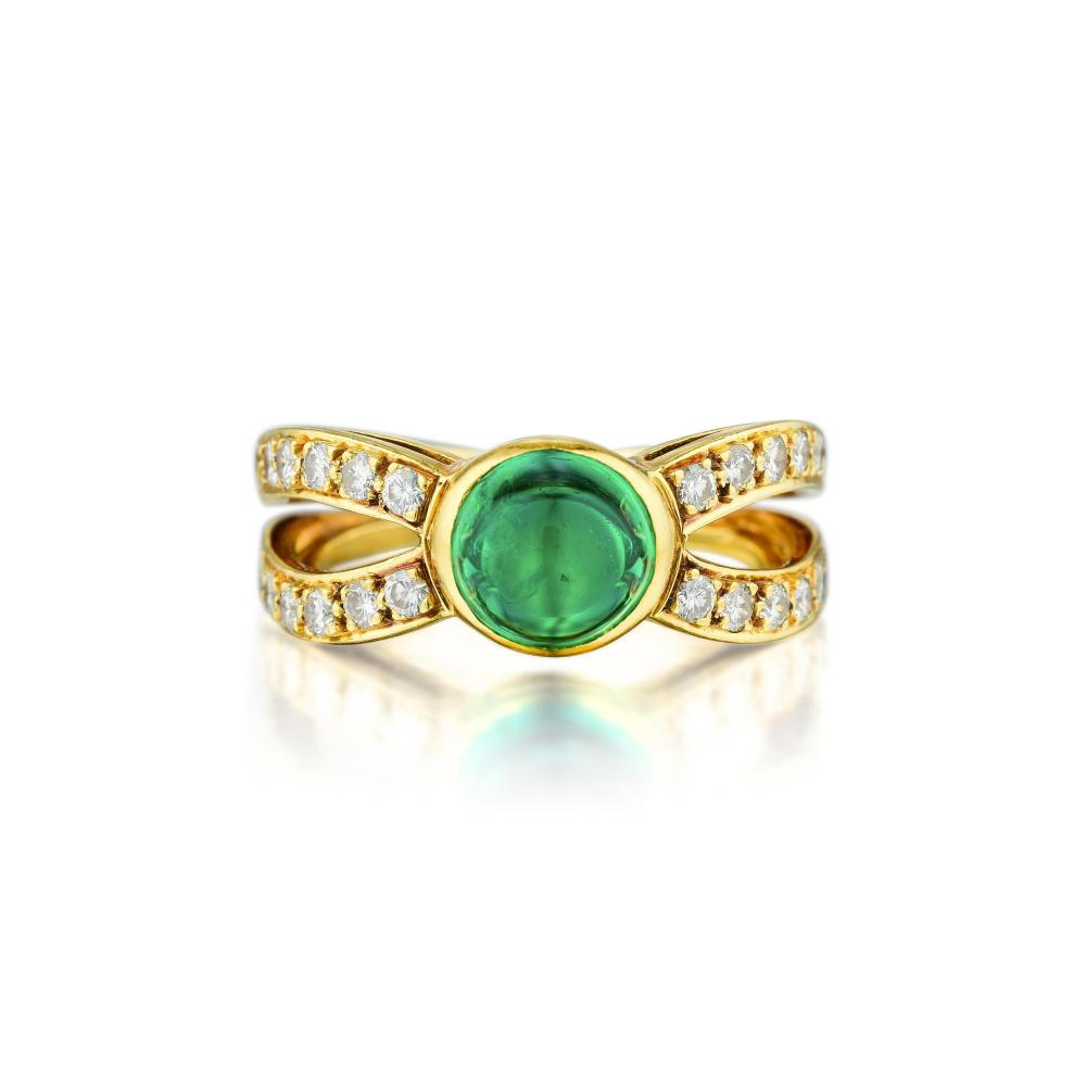 A High Dome Emerald and Diamond Ring