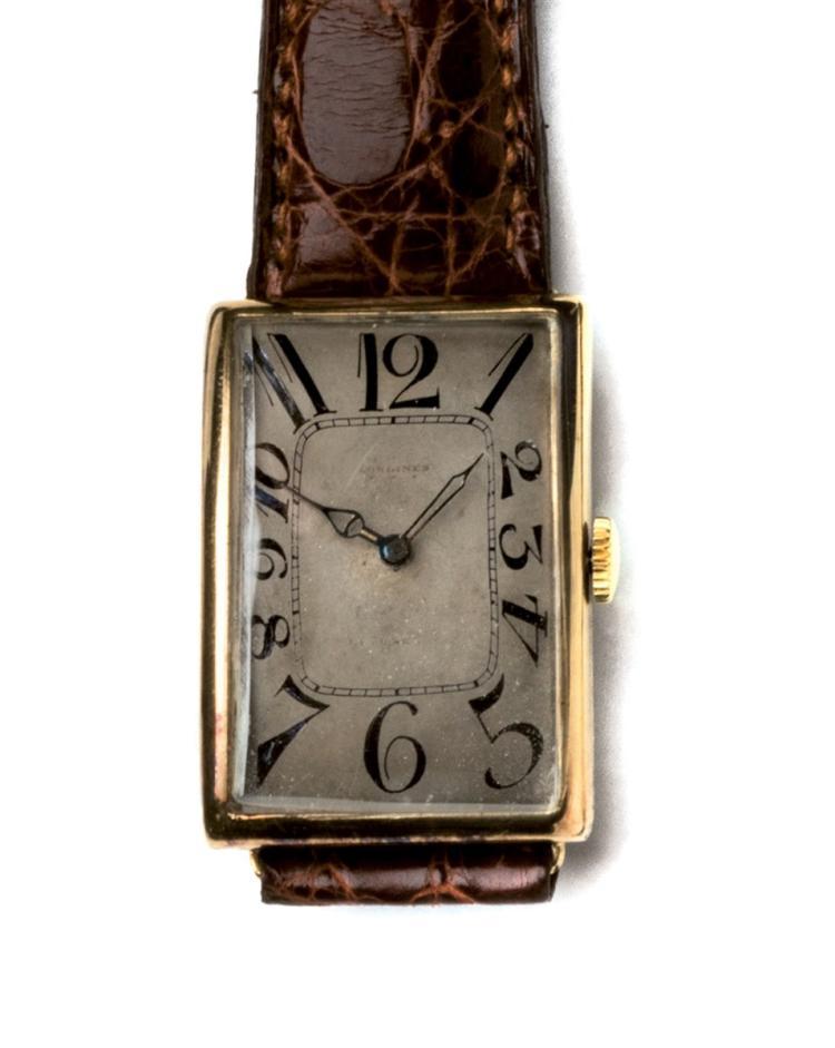 Longines. A yellow gold wristwatch