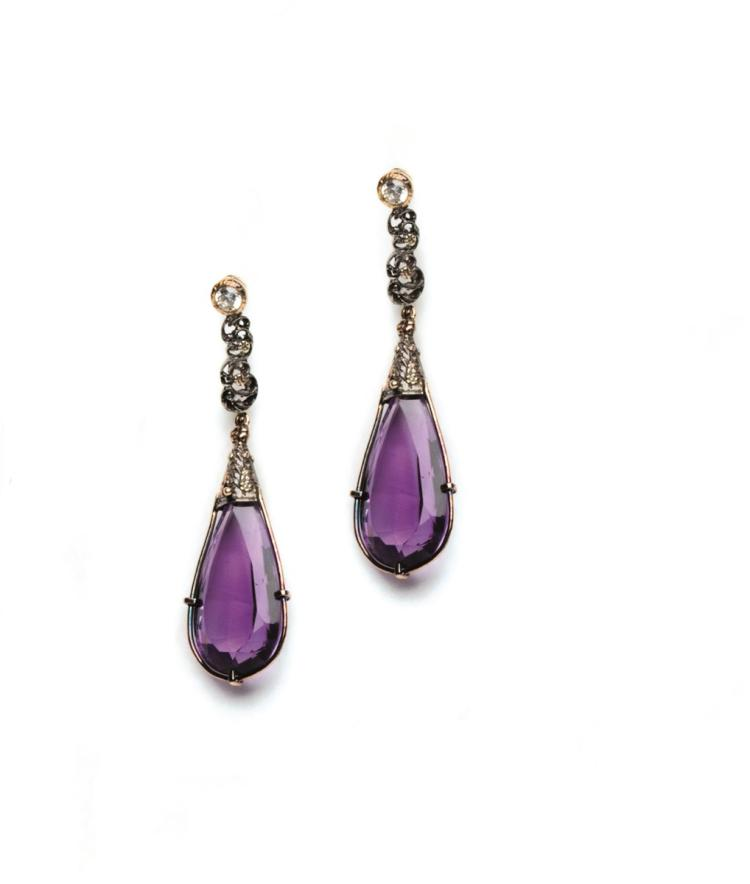 A pair of amethyst and white sapphire earrings.