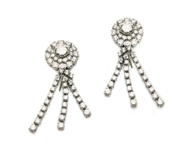 A pair of diamond earrings of circular design