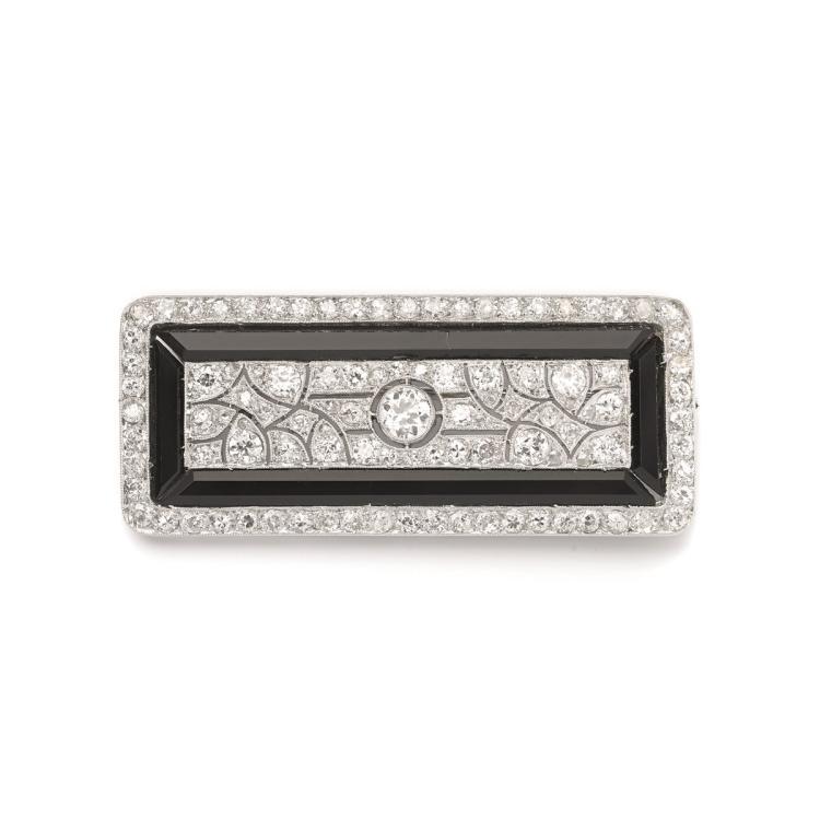 An Art Deco platinum, diamond and onyx brooch