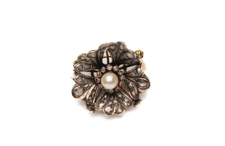 A diamond and natural pearl brooch of floral design