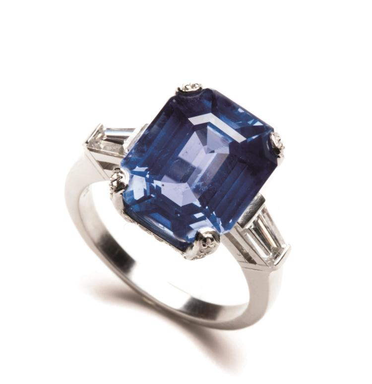 An impressive platinum Burma sapphire ring, set with an emerald-cut sapphire weighing approximately 11.50 carats