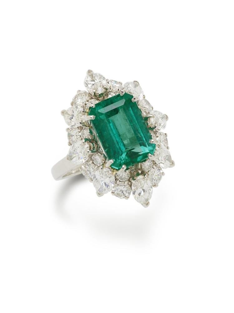 An emerald and diamond ring, in the style of Bulgari, 1960s, set with a rectangular-cut emerald weighing approximately 3.70 carats