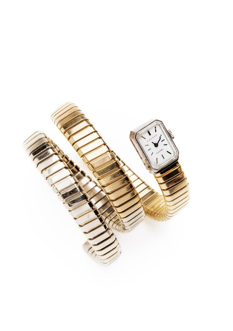Bulgari, Movado. A 18 ct white and yellow gold