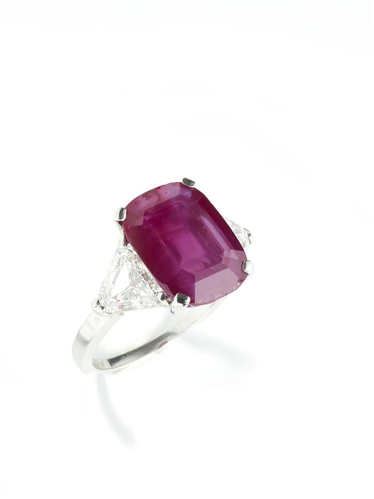 A ruby and diamond ring, Cazzaniga Roma, 1960s, set with a step-cut Burma ruby between a pair of triangular diamonds