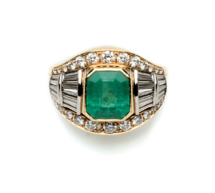 An 18ct gold  emerald and diamond cocktail ring