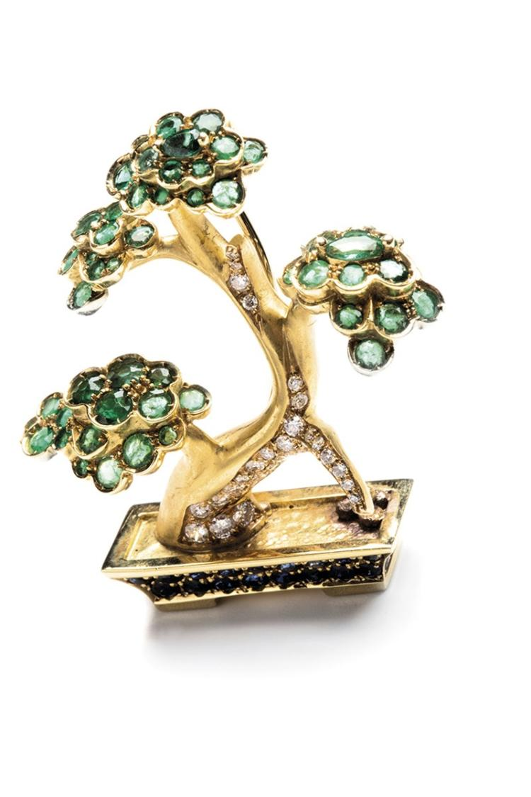 An 18ct gold sapphire, diamond and emerald brooch, depicting a bonsai, set with circular-cut emeralds and sapphires