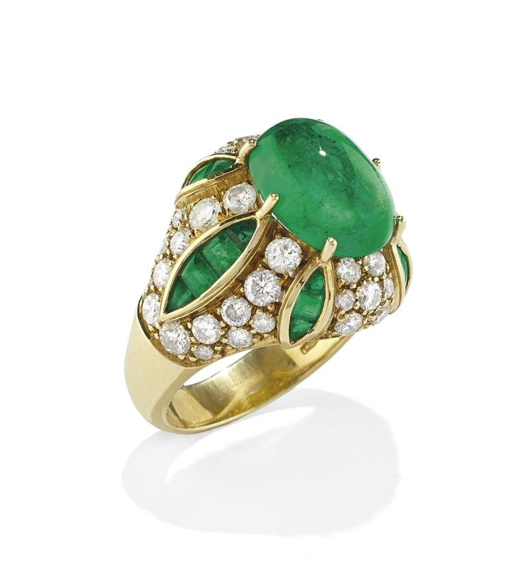 An 18ct gold diamond and emerald dress ring, claw-set with a cabochon emerald weighing approximately 5.50 carats