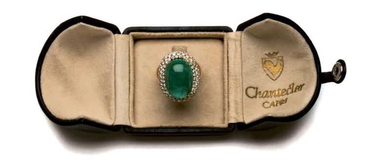 An emerald and diamond ring, Chantecler Capri, claw-set with a cabochon emerald weighing 20.32 carats
