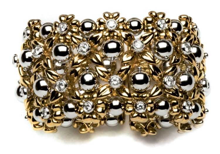 A diamond and 18ct gold bangle, Chantecler Capri, of open work and floral design, set with white gold beads