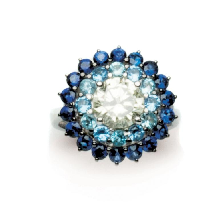 A diamond, topaz and sapphire 18 ct gold ring