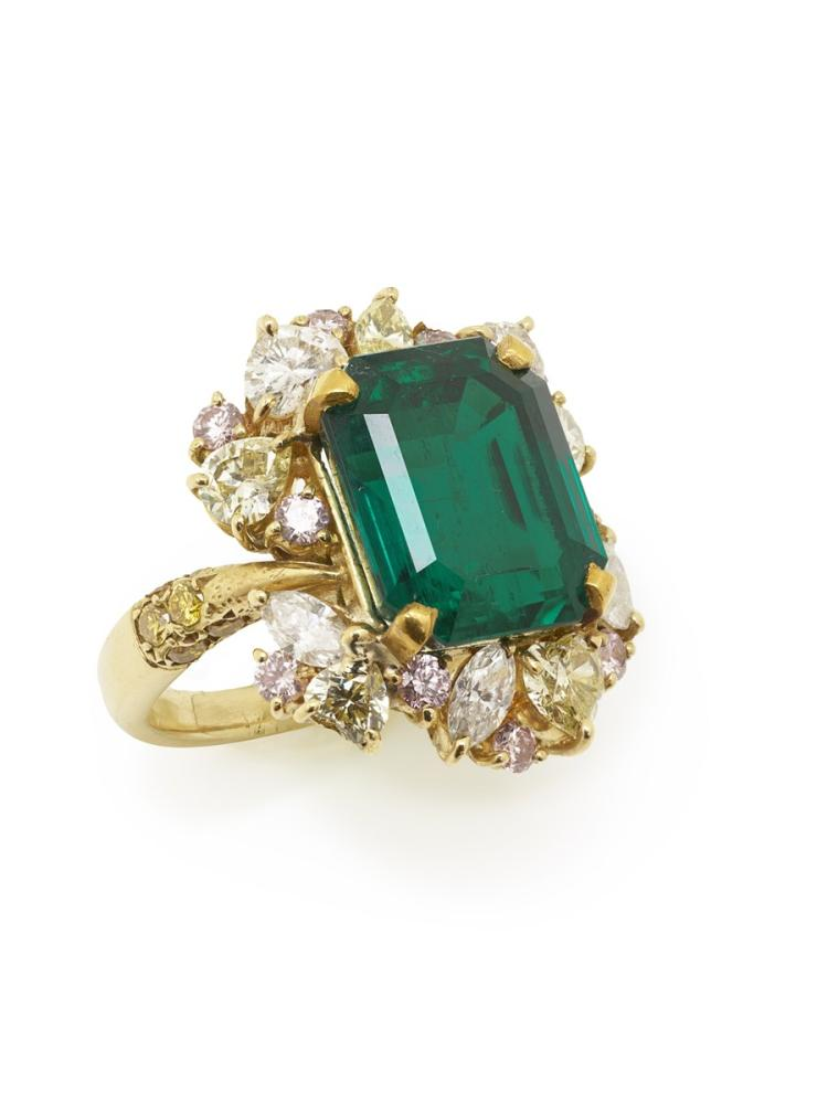 A Bulgari emerald and and diamond 18 ct gold ring