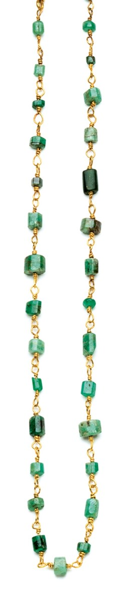 An ancient Roman necklace, II-III century AD, set with rough emeralds drilled beads