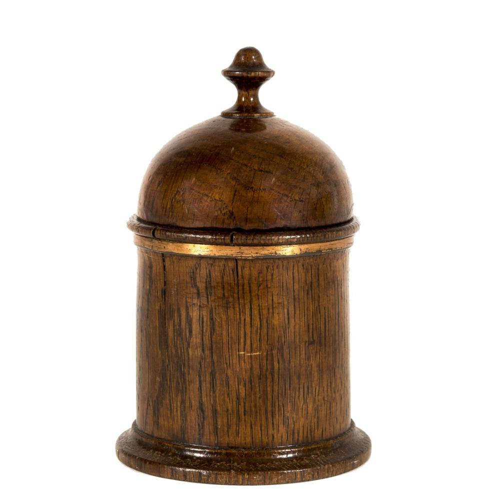 Brönte family.- Haworth Church.- ?Oak tobacco jar made from the wood of Haworth Church, circular wood jar secured with metal band, small split in jar, lid with elaborate knop, printed label in …
