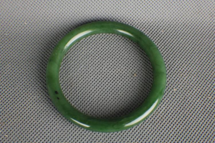 A very fine Chinese Green Jade Bangle