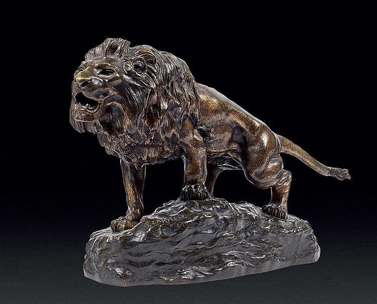 Thomas CARTIER (1879-1943) Lion sur un promontoire rocheux. Bronz