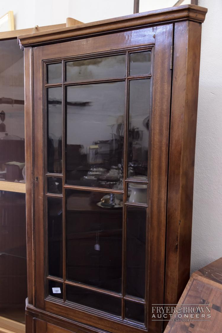 A Mahogany Tall Corner Cabinet With Glass Door Above Cupboar