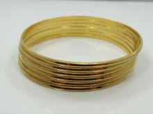 Set of (6) Solid 22K Yellow Gold 3-D Diamond-Cut Bangle Bracelets (65.6 Grams)