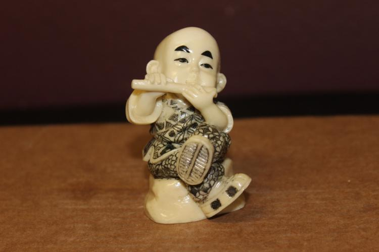 A Chinese Resin Boy