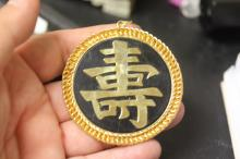 An Onyx? Gold Plated Chinese Pendant