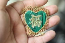 A Malachite and Gold Plated Chinese Character Pendant