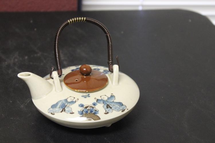 A Chinese/Japanese/Asian Tea Pot