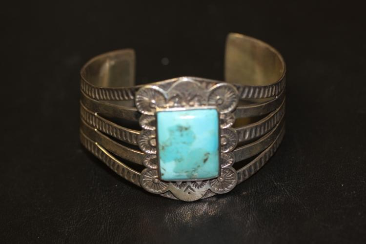 A Large Torquise and Sterling Bangle Bracelet