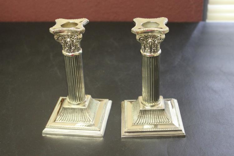 A Pair of Decorative Metal Candle Sticks