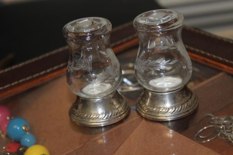 A Pair of Sterling Rim Base Salt and Pepper Shakers