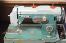 A Retro Torquise SewMor Sewing Machine with Case