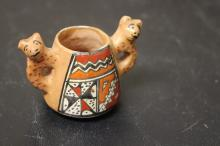 A Miniature Pottery Cup