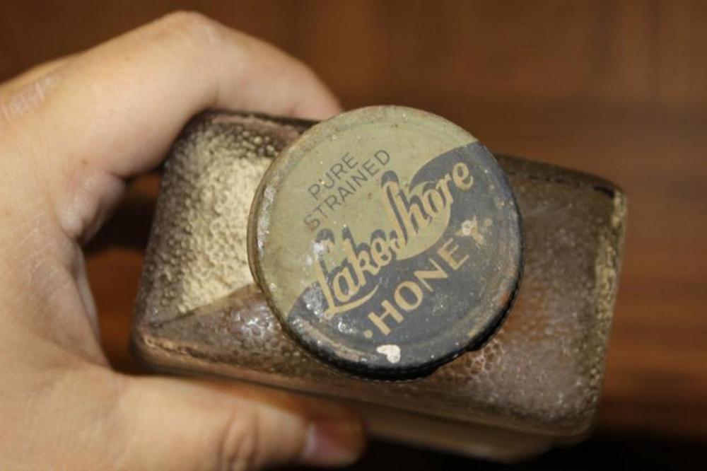 A Vintage 1930's Lakeshore Honey Glass Bottle